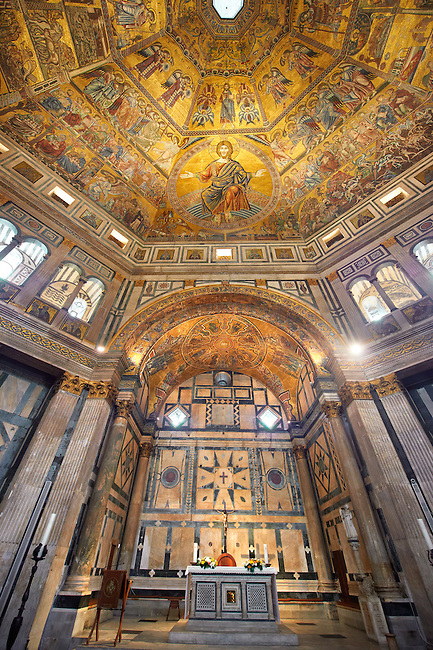The interior of the Bapistry of Florence  Duomo ( Battistero di San Giovanni ) with the altar and  medieval ceiling mosaics of Christ and the last judgement . Florence Italy