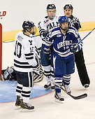 Kevin Limbert (Yale - 10), Nick Jaskowiak (Yale - 5), Ryan Timar (Air Force - 13) - The Yale University Bulldogs defeated the Air Force Academy Falcons 2-1 (OT) in their East Regional Semi-Final matchup on Friday, March 25, 2011, at Webster Bank Arena at Harbor Yard in Bridgeport, Connecticut.