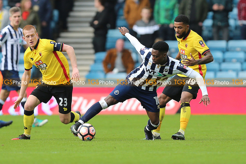 Fred Onyedinma of Millwall tangles with Jerome Sinclair and Ben Watson of Watford during Millwall vs Watford, Emirates FA Cup Football at The Den on 29th January 2017