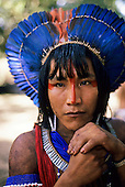 Para State, Brazil. Ta'Kire, a Kayapo Indian warrior with blue feather cocaa headdress at meeting in Altamira.