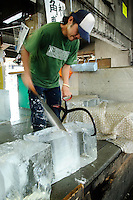 Preparing ice for the fish market stalls, Tsukiji fish market, Tokyo, Japan, April 22 2007.