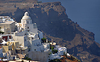 Michael McCollum.6/20/11.Santorini's iconic homes on the cliff side of the Greek island