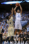 18 November 2015: North Carolina's Brice Johnson (11) and Wofford's Justin Gordon (24). The University of North Carolina Tar Heels hosted the Wofford College Terriers at the Dean E. Smith Center in Chapel Hill, North Carolina in a 2015-16 NCAA Division I Men's Basketball game. UNC won the game 78-58.