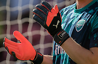 Goalkeeper Bernd Leno of Arsenal Puma protect 2 goalkeeping gloves pre match during the Premier League match between Watford and Arsenal at Vicarage Road, Watford, England on 16 September 2019. Photo by Andy Rowland.