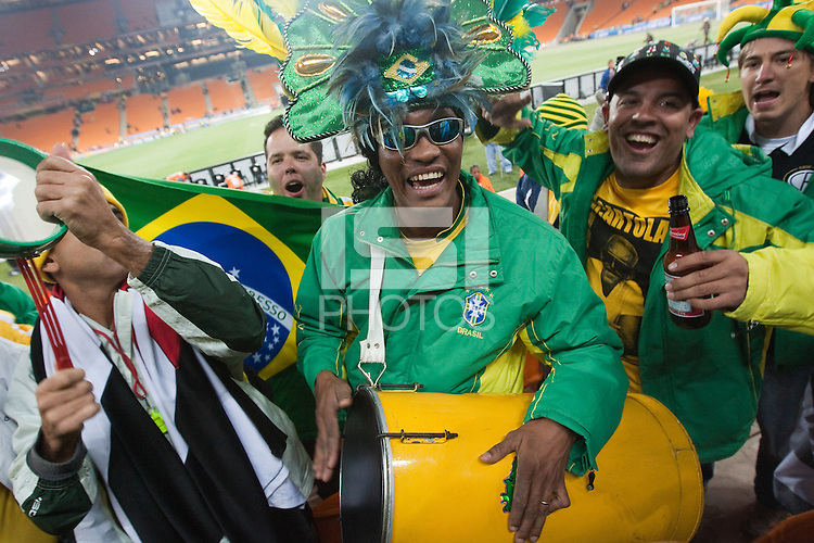 Brazil supporters cheer and beat drums after defeating Ivory Coast 3-1 at a FIFA World Cup first round match between Ivory Coast and Brazil at Soccer City in Johannesburg, South Africa on Sunday, June 20, 2010.