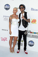 Amber Rose and Wiz Khalifa at the 2012 Billboard Music Awards held at the MGM Grand Garden Arena on May 20, 2012 in Las Vegas, Nevada. © mpi28/MediaPUnch Inc.