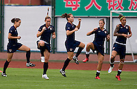 USWNT teammates Stephanie Cox, Christie Rampone, Lauren Cheney, Carli Lloyd, and Natasha Kai warm up at the beginning of  practice at Beijing Normal University for the upcoming semi-final game against Japan in the 2008 Beijing Olympics in Beijing, China.