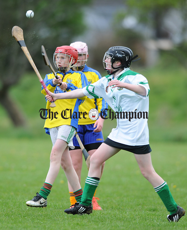 Aoife Shannon of Clare C team in action against Sinead Quinn of Limerick Croagh team C during the Clare Camogie Board U-14 Inter County Blitz at Eire Og and St Flannan's. Photograph by John Kelly.