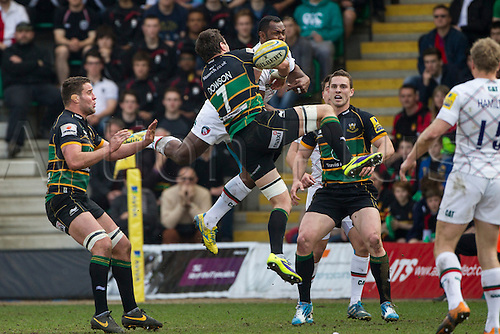 29.03.2014.  Northampton, England.  Phil DOWSON of Northampton Saints and Vereniki GONEVA of Leicester Tigers compete for a high ball during the Aviva Premiership match between Northampton Saints and Leicester Tigers at Franklin's Gardens.  Final score: Northampton Saints 16-22 Leicester Tigers.
