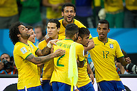 Neymar of Brazil celebrates scoring a penalty goal with team mates after making it 2-1