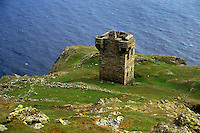 Fortress lookout ruin on a cliff overlooking the ocean, Ireland