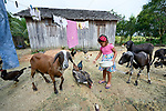 Sindy Kelly Saraiva, 4, feed animals at her home in the countryside near Anapu, in Brazil's northern Para State. This area was forest land until recent decades, when the expansion of the agrarian frontier led to the steady destruction of this part of the Amazon's rain forest. <br /> <br /> Parental consent obtained.