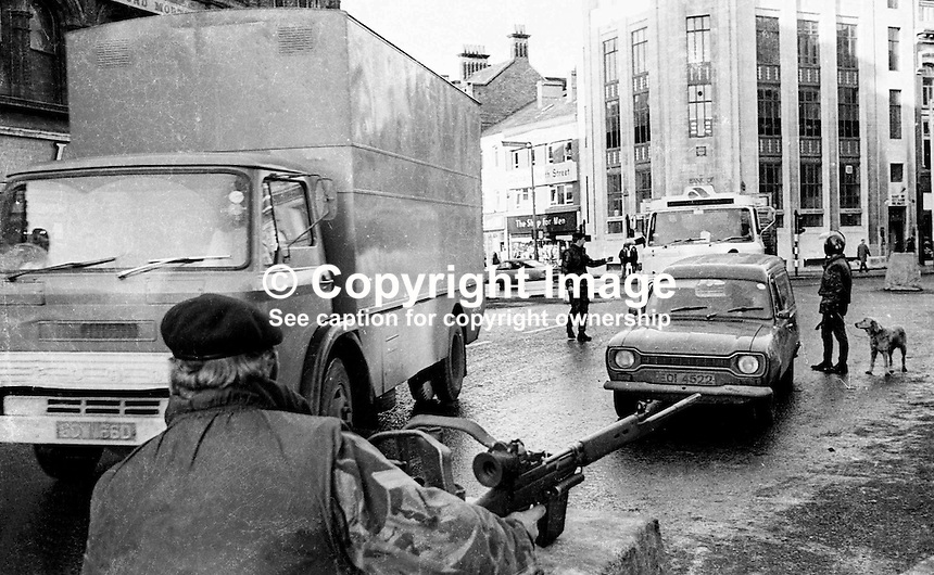 British Army, checkpoint, Royal Avenue, Belfast, N Ireland. Dog trained to sniff out explosives is being used. Ref: 19741120639.<br />