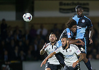 Anthony Stewart of Wycombe Wanderers wins the ball but fails to hit the target during the Capital One Cup match between Wycombe Wanderers and Fulham at Adams Park, High Wycombe, England on 11 August 2015. Photo by Andy Rowland.