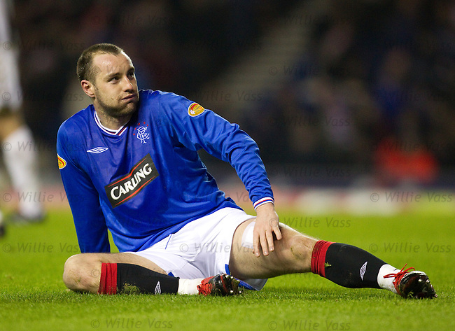 Kris Boyd sits down and takes a break in the first half