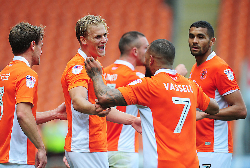 Blackpool's Brad Potts and Kyle Vassell celebrate their sides second goal, an own goal by Exeter City's Troy Brown (not in picture)<br /> <br /> Photographer Kevin Barnes/CameraSport<br /> <br /> Football - The EFL Sky Bet League Two - Blackpool v Exeter City - Saturday 6th August 2016 - Bloomfield Road - Blackpool<br /> <br /> World Copyright &copy; 2016 CameraSport. All rights reserved. 43 Linden Ave. Countesthorpe. Leicester. England. LE8 5PG - Tel: +44 (0) 116 277 4147 - admin@camerasport.com - www.camerasport.com