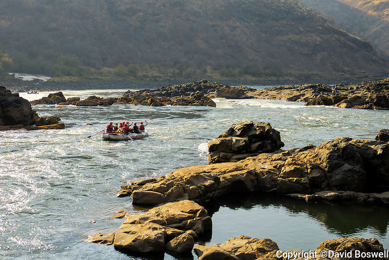 A raft preparing to enter Upper Moemba Falls, a class V rapid on the Zambezi River in East Africa.