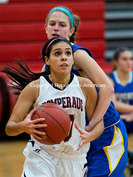 SOUTHBURY, CT - 20 December 2013-122013EC06--   Pomperaug's Hannah Metcalf eyes the basket as Brookfield's Carolyn Marron defends Friday night in Southbury. Erin Covey Republican-American.