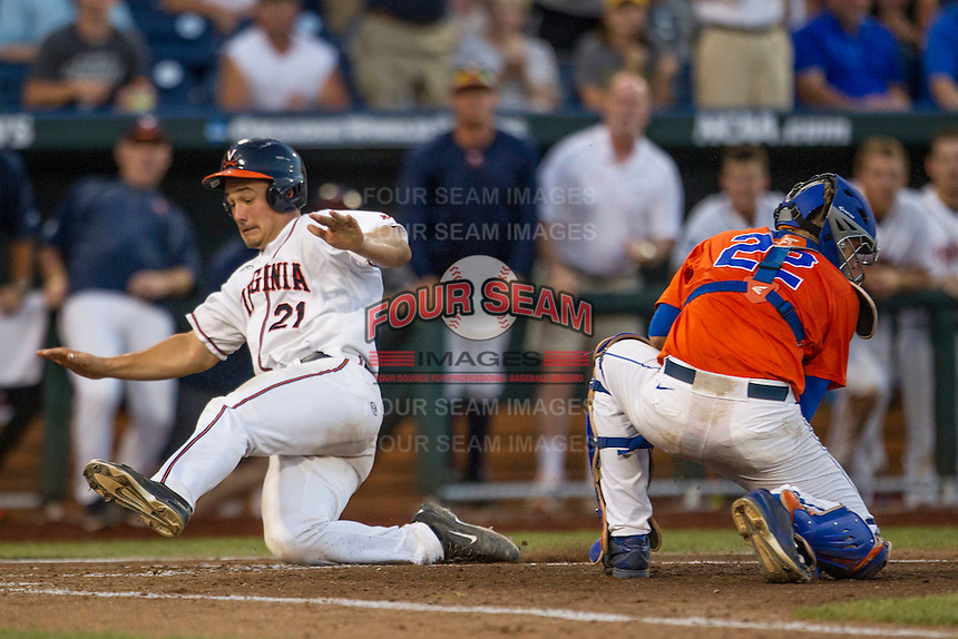 Virginia Cavaliers catcher Matt Thaiss (21) slides ahead of the tag by Florida Gators catcher JJ Schwarz (22) in Game 13 of the NCAA College World Series on June 20, 2015 at TD Ameritrade Park in Omaha, Nebraska. The Cavaliers beat the Gators 5-4. (Andrew Woolley/Four Seam Images)