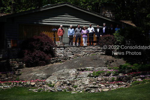 (L-R) European Council President Herman Van Rompuy, Italian Prime Minister Mario Monti, British Prime Minister David Cameron, German Chancellor Angela Merkel, U.S. President Barack Obama, French President Francois Hollande and Canadian Prime Minister Stephen Harper arrive for a group photo during the 2012 G8 Summit at Camp David May 19, 2012 in Camp David, Maryland. Leaders of eight of the worlds largest economies meet over the weekend in an effort to keep the lingering European debt crisis from spinning out of control.  .Credit: Luke Sharrett / The New York Times / Pool via CNP