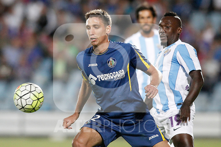 Getafe's Stefan Scepovic (l) and Malaga's Arthur Boka during La Liga match.September 18,2015. (ALTERPHOTOS/Acero)