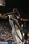 Freshman DeMarcus Cousins gets knocked over by a Campbellsville player during the first period of the first exhibition game at Rupp Arena on Monday, Nov. 2, 2009.