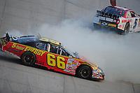 Sept. 20, 2008; Dover, DE, USA; Nascar Nationwide Series driver Landon Cassill (5) and Steve Wallace (66) crash during the Camping World RV 200 at Dover International Speedway. Mandatory Credit: Mark J. Rebilas-