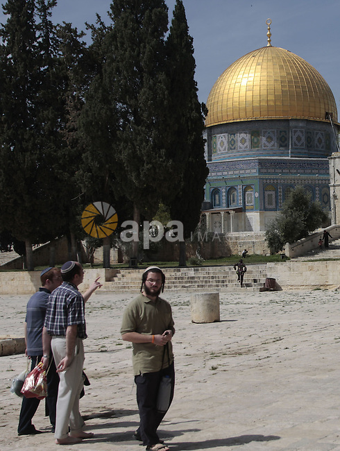 """Jewish tourists walk in front of the Dome of the Rock, on the compound known to Muslims as al-Haram al-Sharif and to Jews as Temple Mount, in Jerusalem's Old City March 24, 2010. Forty-two years come June since Israel captured Jerusalem, the city remains at the heart of the Middle East conflict. For Israelis, it is their """"eternal and indivisible"""" capital. For Palestinians, there can be no peace deal until Israel cedes them control over at least part of the city. Photo by Mohamar Awad"""