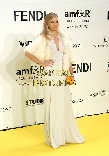 YVONNE SCIO .Inauguration for the amfARr's Cinema Against AIDS during the 2nd Annual Rome Film Festival, Rome, Italy, .26 October 2007..full length white dress cream fur jacket coat hand on hip orange clutch bag.CAP/CAV.©Luca Cavallari/Capital Pictures.