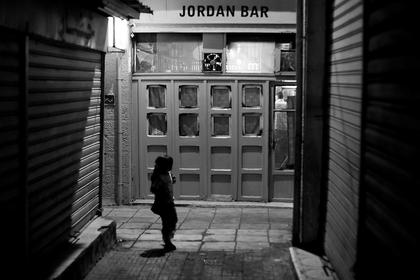 A young Iraqi refugee walks through the laneways of downtown Amman at night, Amman, Jordan, September 2009. Photo: Ed Giles.