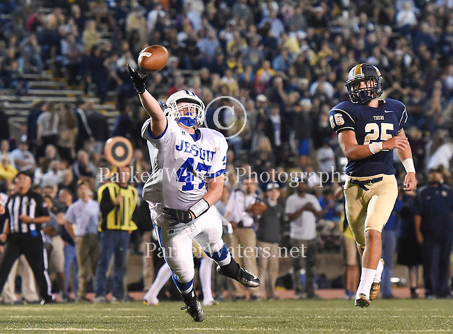 Holy Cross tops Jesuit, 28-21, in a double OT win at Tad Gormley Stadium in New Orleans (10/2/2015). This classic New Orleans prep matchup has been played every year since  1922.