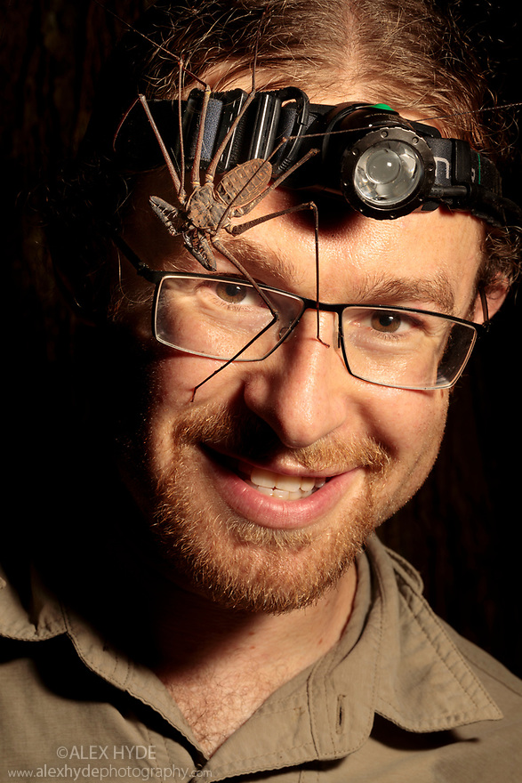 Tailless Whipscorpion  (Heterophrynus elephas) on photographer Alex Hyde's face. Manu Biosphere Reserve, Peru. November.