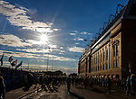 Fans arrive for the match at Ibrox as the sun sets on Edmiston Drive