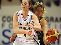 Opals guard Jessica Bibby reaches round to dispossess Erin Rooney during the International women's basketball match between NZ Tall Ferns and Australian Opals at Te Rauparaha Stadium, Porirua, Wellington, New Zealand on Monday 31 August 2009. Photo: Dave Lintott / lintottphoto.co.nz