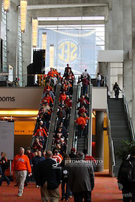 Fans on the escalators at the Georgia Conference Center heading to the SEC Fan Zone