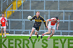 Ian Sommers Currow breaks away from Rathmore John Buckley during their O'Donoghue cup semi final in Fitzgerald Stadium on Sunday