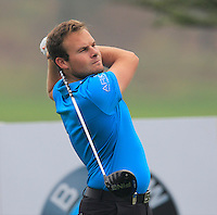 Tyrrell Hatton (ENG) tees off the 15th tee during Friday's Round 2 of the 2014 BMW Masters held at Lake Malaren, Shanghai, China 31st October 2014.<br /> Picture: Eoin Clarke www.golffile.ie