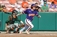 Left Fielder Tyler Slaton #18 swings at a pitch during a  game against the Miami Hurricanes at Doug Kingsmore Stadium on March 31, 2012 in Clemson, South Carolina. The Tigers won the game 3-1. (Tony Farlow/Four Seam Images).