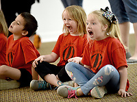 NWA Democrat-Gazette/DAVID GOTTSCHALK  Tess Cravens (from right), Ember Crawley and Cole Driskell, kindergarten students from Glenn Duffy Elementary School in Gravette, participate Wednesday, April 10, 2019, in an Act it Out pre show experience at the Arts Center of the Ozarks in Springdale. The students were at the center to see Balloonacy, part of the Little Trike Series, at the center. The performance continues today through Saturday.
