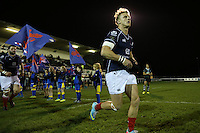 London Scottish players enter the pitch ahead of the Greene King IPA Championship match between London Scottish Football Club and Nottingham Rugby at Richmond Athletic Ground, Richmond, United Kingdom on 16 October 2015. Photo by David Horn.