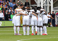 Pictured: Swansea players huddle prior to kick off<br />