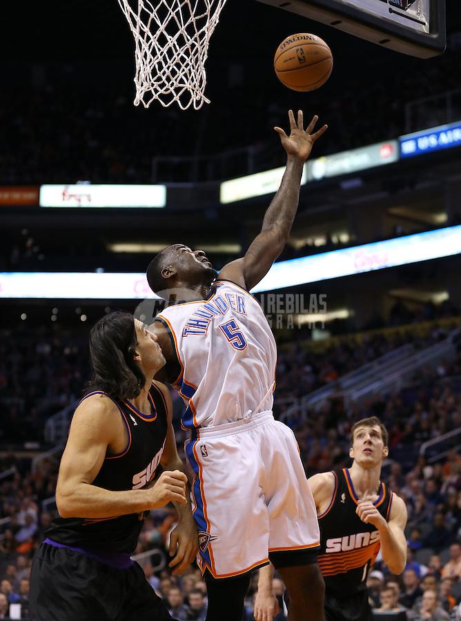 Feb. 10, 2013; Phoenix, AZ, USA: Oklahoma City Thunder center Kendrick Perkins reaches for a rebound against the Phoenix Suns at the US Airways Center. Mandatory Credit: Mark J. Rebilas-
