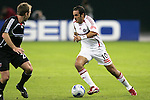 1 November 2007: Chicago's Cuauhtemoc Blanco (right) looks to dribble past DC United's Brian Namoff (left). The Chicago Fire tied DC United 2-2 at RFK Stadium in Washington, DC in the second leg of a first round Major League Soccer playoff match. Chicago advanced on aggregate goals, 3-2.