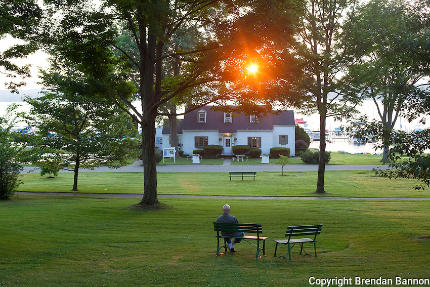 A  man enjoys the surise from a bench on the grounds of the Chautauqua Institution. Chautauqua, NY. June 27, 2014. Photo by Brendan Bannon