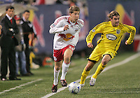 New York Red Bulls' Luke Sussano (32) beats Columbus Crew's Nicholas Hernandez off the dribble during the second half of an MLS soccer match at Giants Stadium in East Rutherford, N.J. on Saturday, April 5, 2008.