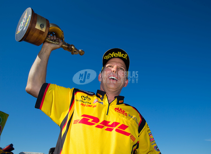 Oct 18, 2015; Ennis, TX, USA; NHRA funny car driver Del Worsham celebrates after winning the Fall Nationals at Texas Motorplex. Mandatory Credit: Mark J. Rebilas-USA TODAY Sports