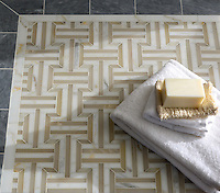 Gaston, a handmade mosaic shown in polished Cream Onyx, Calacatta Tia, and Allure, is part of the Illusions™ collection by Sara Baldwin for New Ravenna.