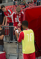 15 September 2012: Toronto FC forward Quincy Amarikwa #18 signs an autograph after the warm-up in an MLS game between the Philadelphia Union and Toronto FC at BMO Field in Toronto, Ontario..The game ended in a 1-1 draw..