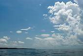 Pará State, Brazil. Clouds over the wide river below Vitoria do Xingu.