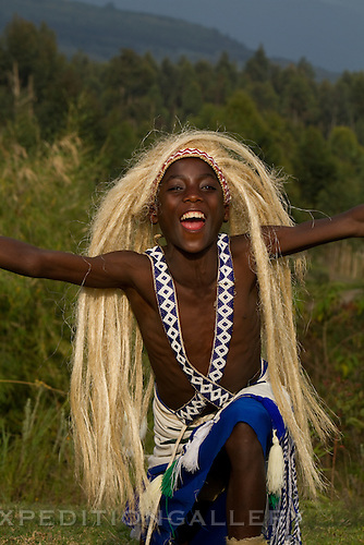 Rwandan boy wearing grass wig while performing traditional Intore style dance near Musanze (Ruhengeri), Rwanda. [NO MODEL RELEASE]
